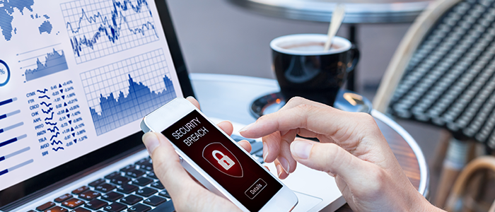 Person typing on phone that says security breach | Employee training and Cybersecurity